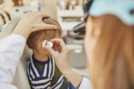 ENT physician examining ear of a boy - ZEDF01228