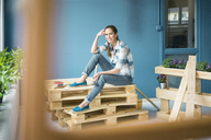 Beautiful woman refurbishing her home with pallets - MOEF00861