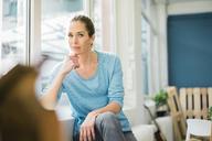 Woman refurbishing her new home, taking a break - MOEF00906
