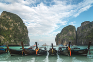 Thailand, Phi Phi Islands, Ko Phi Phi, moored long-tail boats in a row - KKAF00888
