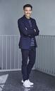 Portrait of smiling businessman with stubble wearing blue suit - PNEF00539