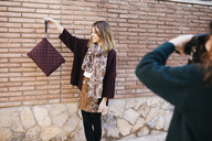 Fashion designers doing a photo shoot of their new products - JRFF01557