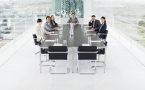 Portrait of smiling business people at conference room table - CAIF00027