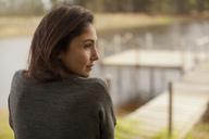 Pensive woman at lakeside - CAIF00099