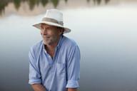 Smiling man at lakeside - CAIF00102