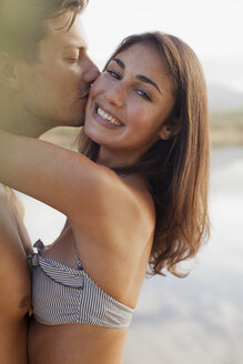 Close up portrait of couple kissing - CAIF00108
