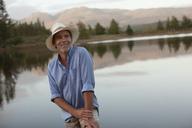 Smiling man at lakeside - CAIF00153