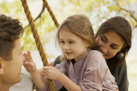 Close up of family on swing - CAIF00171