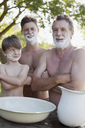 Portrait of multi-generation men with arms crossed and shaving cream on faces - CAIF00201