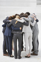 Business people in huddle - CAIF00222