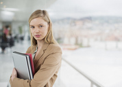 Portrait of serious businesswoman at window - CAIF00228