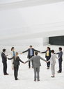 Business people holding hands in circle - CAIF00258