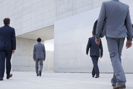 Businessmen walking toward cultural center - CAIF00279