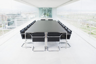 Empty conference room overlooking city - CAIF00282