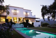 Luxury lap pool and villa at dusk - CAIF00333