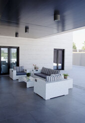 Sofa and chairs on luxury patio - CAIF00375