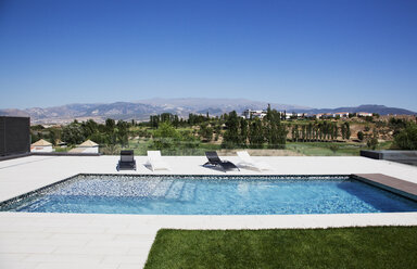 Lounge chairs and swimming pool - CAIF00378