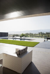 Luxury patio overlooking swimming pool - CAIF00387