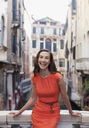 Portrait of smiling woman in Venice - CAIF00505