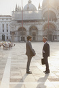 Businessmen talking in St. Mark's Square in Venice - CAIF00577