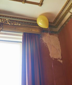 Balloon floating in corner of ornate room - CAIF00745