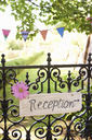 Reception sign on wrought iron fence - CAIF00757
