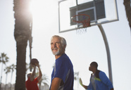 Older men playing basketball on court - CAIF00859
