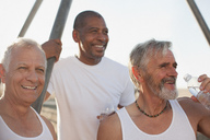 Older men relaxing outdoors together - CAIF00874