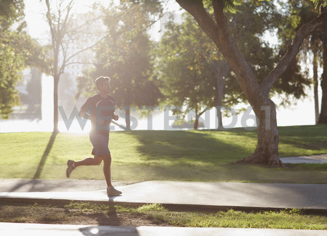 Man jogging in park - CAIF00898