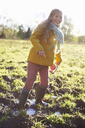 Girl wading in muddy field - CAIF00973