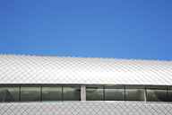 Roof of modern building and blue sky - CAIF01030