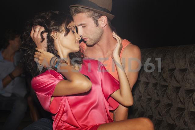 Sexy couple hugging in nightclub - CAIF01066 - Sam Edwards/Westend61