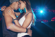 Sexy couple dancing under spotlight - CAIF01090