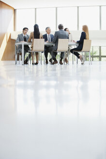 Business people meeting at table in conference room - CAIF01123