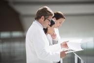 Doctors reviewing medical charts - CAIF01150