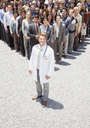 Portrait of confident doctor with business people in background - CAIF01183