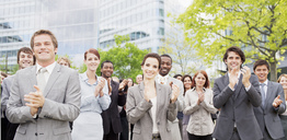 Portrait of clapping business people in crowd - CAIF01201
