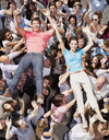 Portrait of man and woman crowd surfing - CAIF01210