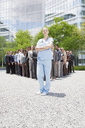 Portrait of confident nurse with business people in background - CAIF01213