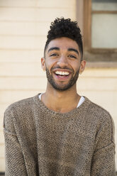 Portrait of happy young man outdoors - SUF00467