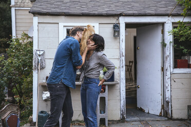 Man wearing funny mask kissing woman - SUF00515