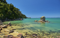 New Zealand, South Island, Abel Tasman National Park, tourists on rock in the sea - MRF01748