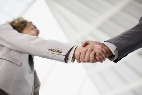 Close up of businessman and businesswoman shaking hands - CAIF01263