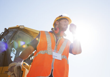 Worker using walkie-talkie on site - CAIF01347