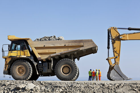 Workers and machinery in quarry - CAIF01359