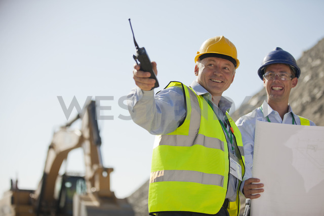 Businessmen talking in quarry - CAIF01389