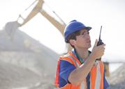 Worker using walkie-talkie in quarry - CAIF01407