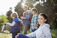 Family fishing together in tall grass - CAIF01470