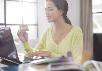 Woman shopping on laptop - CAIF01527