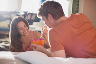 Couple eating breakfast in bed together - CAIF01539